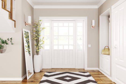 Moderner Eingangsbereich im skandinavischen Landhausstil mit Garderobe und Parkettfußboden