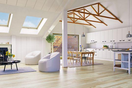 offene wohnkuche im dachgeschoss moderner landhausstil weisse kuchenzeile rundsessel gepolstert vor kamin